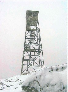 The Hurricane Mountain fire tower weathering the winter winds and snow during December 2004. Courtesy Warren Johnsen